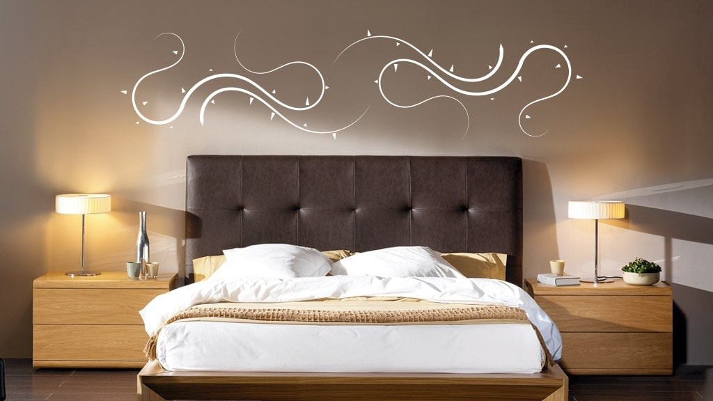 Ideas para cabeceros de cama sorprendentes for Vinilos pared dormitorio matrimonio