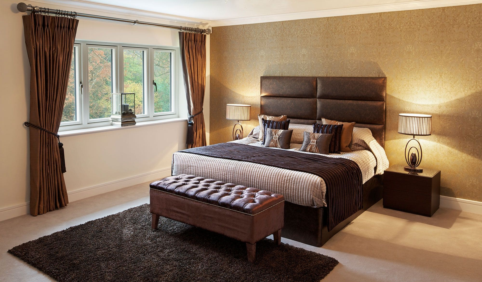 decoración dormitorio elegante y actual con cabecero de piel