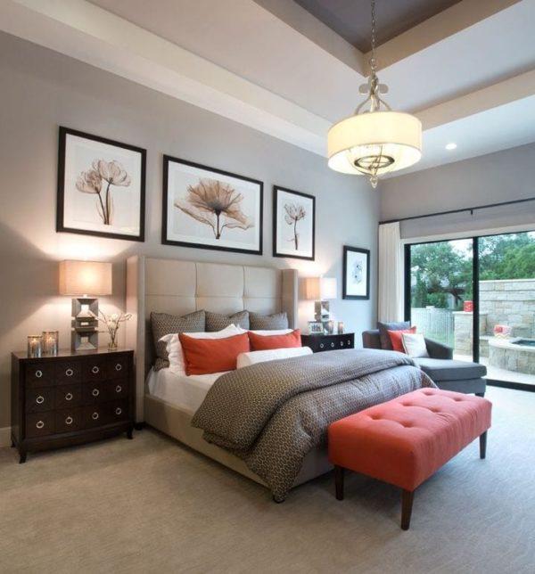 dormitorio acogedor con toques de rojo y cabecero grande