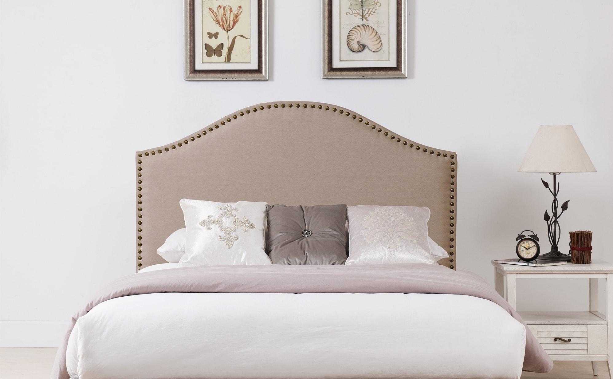 Cabeceros tapizados con tachuelas estilo y confort for Cabeceros de cama tapizados